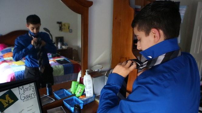 Soren Barnett, 18, gets dressed at home in Montgomery. (Andre Malok | NJ Advance Media for NJ.com)