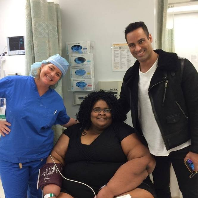Page sits between her doctor, David Gruener, and her therapist, Lizabeth Gottsegen. (Photo courtesy of Katia Page)