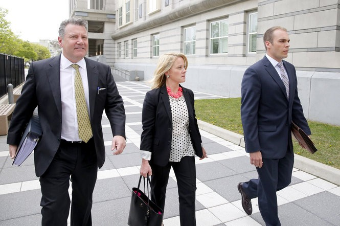 Bridget Anne Kelly leaves court with her attorneys at the Martin Luther King Jr. Federal Courthouse in Newark. (Aristide Economopoulos | NJ Advance Media for NJ.com)