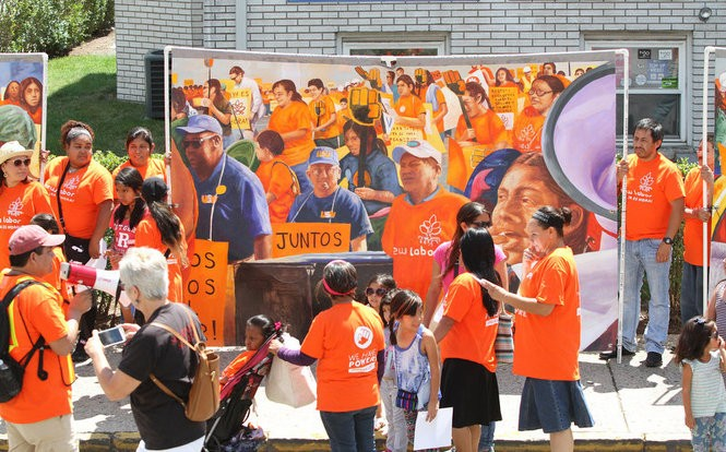 Temp workers participate a march organized by the activist group New Labor in New Brunswick in August. The marchers carried new murals commissioned by the group depicting the plight of temp workers in New Jersey. (Andrew Miller | For NJ Advance Media)