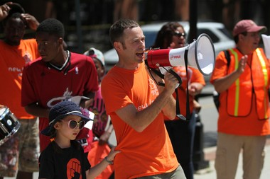 Louis Kimmel, executive director of New Labor, speaks to temp workers as they marched through New Brunswick in August carrying a new mural depicting the plight of blue-collar workers in the temp industry. (Andrew Miller | For NJ Advance Media)