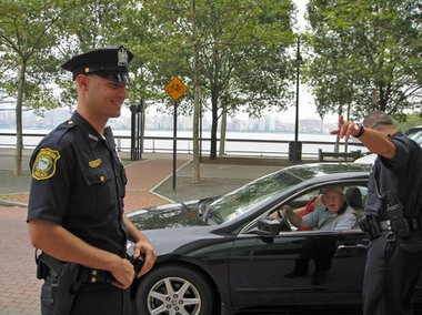 Officers James Babro, left, and William Oquendo tell a visitor how to find the ferry and where they can park in Hoboken in this 2008 file photo.