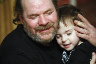 In this 2008 photo, Verner Dilts, the father of Molly Dilts, hugs Molly's son, Jeremiah, in the family's home in Black Lick, Pa.. Verner Dilts is raising the boy, now 11. (File photo)