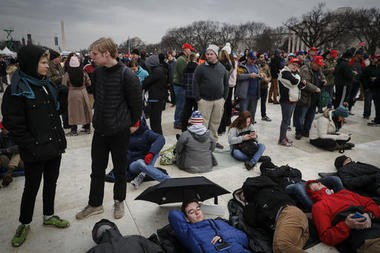 Spectators gather on the National Mall in Washington, Friday, Jan. 20, 2017, before the presidential inauguration of Donald Trump.