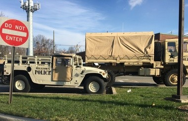 Milltown's Humvee and military cargo truck parked in the borough police department's parking lot.