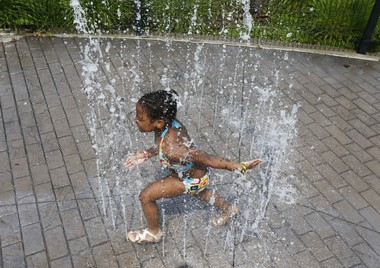 A young girl enjoys the water at the spray ground at Riverfront Park in Newark. (Ed Murray | NJ Advance Media for NJ.com)
