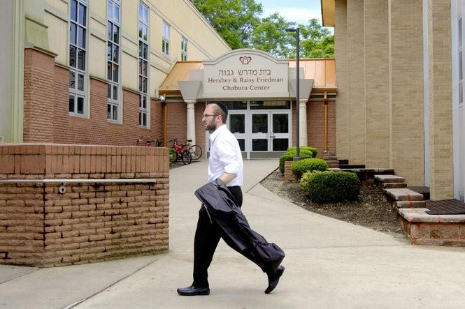 A student walks past one one Beth MedrashGovoha's academic buildings in Lakewood. (Aristide Economopoulos   NJ Advance Media for NJ.com)