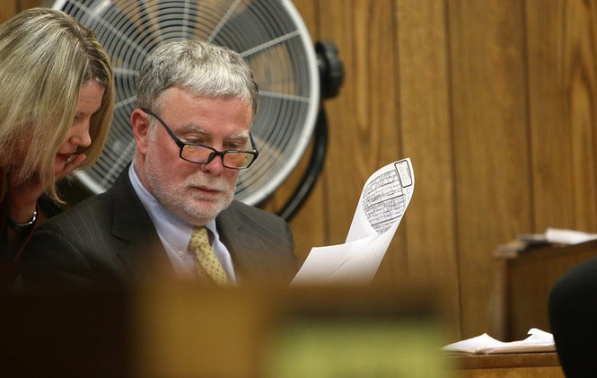 Police interrogation expert James Trainum reviews evidence in the case as Eileen Kane, a prosecutor in Passaic County, looks on.