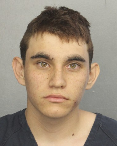 This photo provided by the Broward County Jail shows Nikolas Cruz. Authorities say Cruz, a former student opened fire at Marjory Stoneman Douglas High School in Parkland, Fla., Wednesday, Feb. 14, 2018, killing more than a dozen people and injuring several. (Broward County Jail via AP)