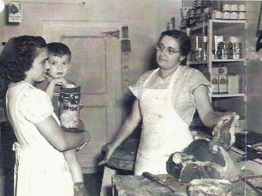 Mary Morello displays a choice cut of meat for a customer in the G. Morello and Sons Market on Cherry Street in Vineland in this photo from the late 1960s.