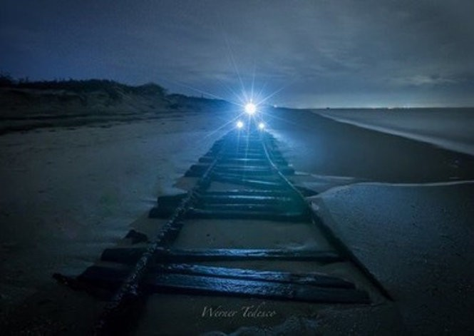 """In this long-exposure image, the """"ghost tracks"""" in Cape May County are revealed. Photographers Werner Tedesco and Dave Callahan used lights to simulate a train engine on the tracks over the weekend. (Photo courtesy of Werner Tedesco)"""