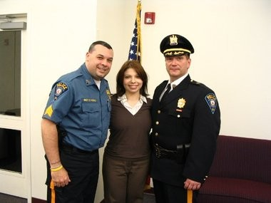 Montclair State University Police Sgt. Christopher Vidro, his wife Toni Lyn Vidro and Chief Paul Cell pose for a photo in 2004. (Courtesy of Montclair State University Police)