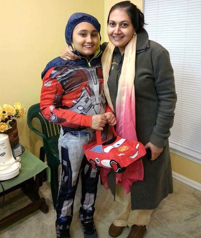 Areen Chakrabarti, 14, with his mother, Rumpa Banerjee. (Photo courtesy of Christopher Bagnata)