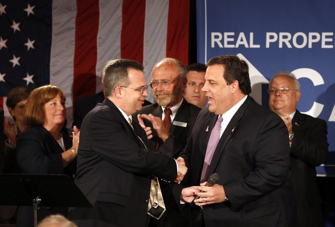Jim Rilee greets then-Gov. Chris Christie at a town hall meeting in Roxbury in 2010