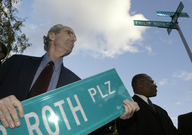 Roth, with former Mayor Sharpe James, holds a copy of a new street sign with his name, after a plaque was unveiled on Roth's boyhood home on Summit Ave. (John Munson | Star-Ledger file photo)