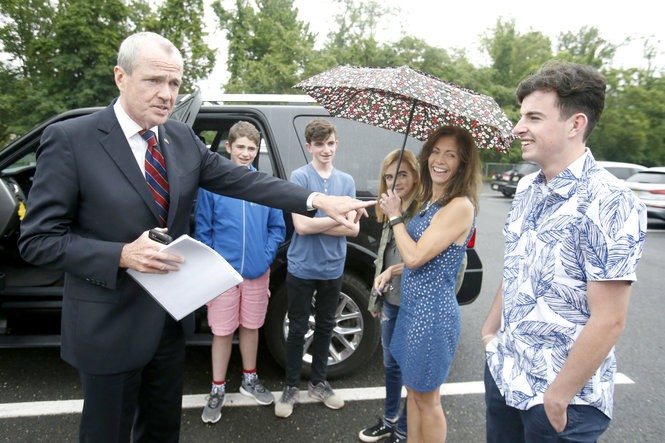 Phil Murphy jokes with his son Joshua, with his wife Tammy and their younger children, Sam, Charlie, and Emma, on election day outside the Fairview Elementary School. (Aristide Economopoulos | NJ Advance Media for NJ.com)