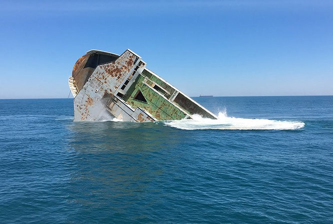 The bow of the MV Twin Capes slips beneath the waters of the Atlantic Ocean on Friday. The old ferry is now part of an artificial reef. (Bill Gallo Jr. | For NJ.Com)