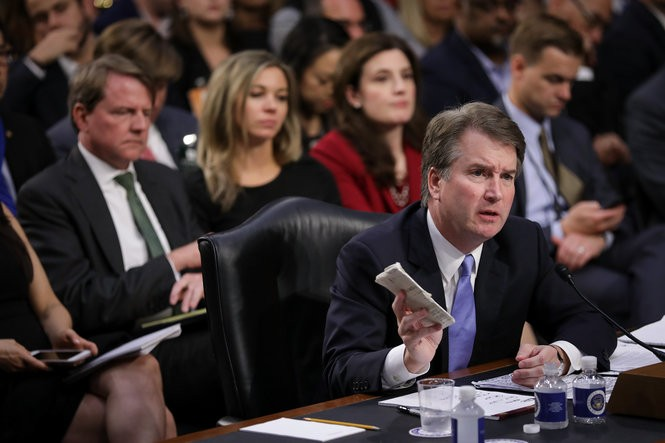Supreme Court nominee Brett Kavanaugh holds a copy of the Constitution as he testifies before the Senate Judiciary Committee on Sept. 6. Three women have accused him of sexual misconduct. (Drew Angerer   Getty Images)