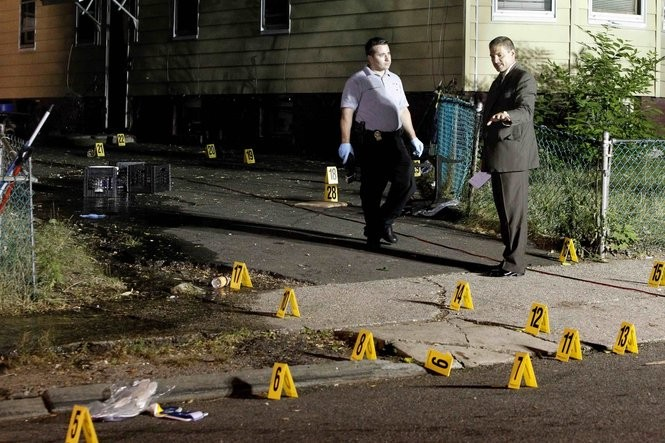 Capt. Mike DeMaio, right, talks to Detective Telmo Silvestri about photographing the evidence at the Newark scene where Al-Aziz Stewart, 15, was killed andseven others wounded on July 12, 2011. (Star-Ledger file photo)