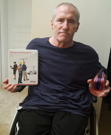 Thomas McDonald displays some of the awards he received during his time working for Verizon. (Submitted photo)
