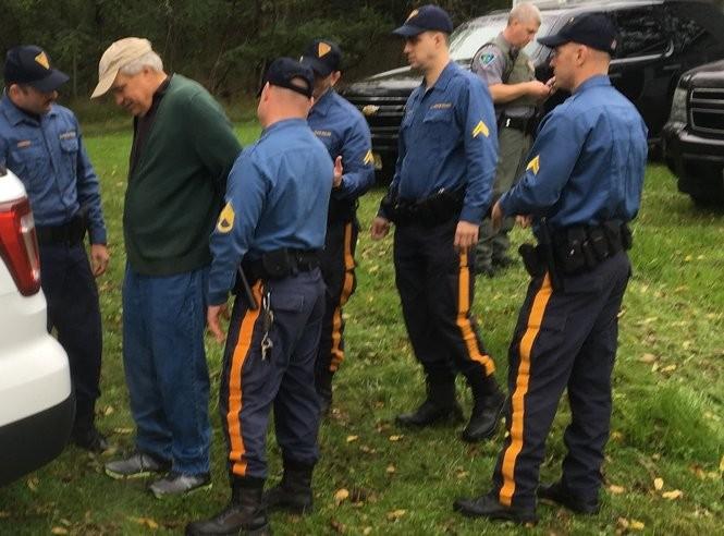 Bill Crain, on left, being taken into custody in Fredon, Oct. 8, 2018 (Rob Jennings / NJ Advance Media for NJ.com)