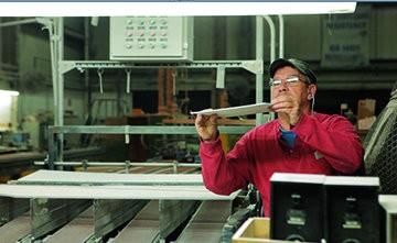 A Mannington associate performs quality control testing at the Salem facility.