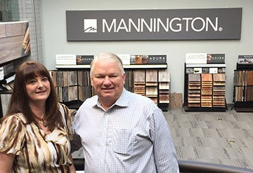 Executive secretary and longtime employee Christine Jackson with Keith Campbell, chairman of the board at Mannington Mills.