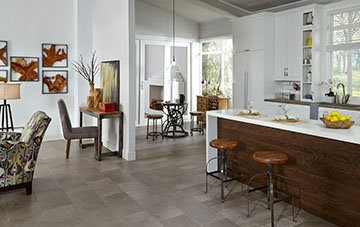 Upscale contemporary, this sleek Adura luxury vinyl tile floor showcases a mix of light and dark shadows in both tile and plank size offerings.