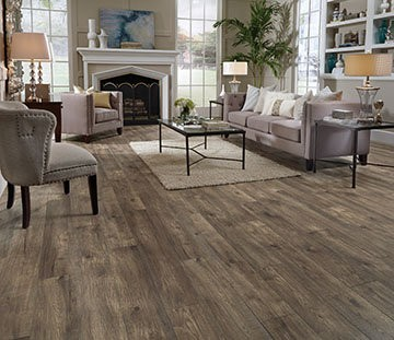 Hillside Hickory is a laminate that features a reclaimed hardwood look and captures the essence of naturally aged wood. Its rustic graining and irregular bevel creates true realism from plank to plank. Available from the Restoration Collection.