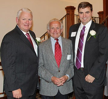 Jim Smith, center, winner of the 2015 John B. Campbell Award, with Chairman of the Board Keith Campbell, left, and Mannington Senior Vice President Zack Zehner.