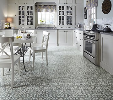 Filigree resilient flooring is inspired by vintage ornate metalwork with a vintage floral motif in a weathered, handpainted pattern.