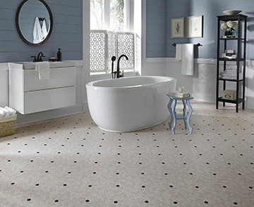 A 1920s throwback design, Penny Lane resilient flooring is a small-scale marble hexagon design with colorful insets.