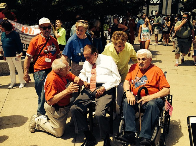 Sen. Robert Dole and his wife Elizabeth seen here with Honor Flight veterans. The Doles have attended the group's visit to the WWII Memorial for the past several years.