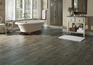 The look of wide plank hardwood in a luxury vinyl sheet floor that's perfect for any room.
