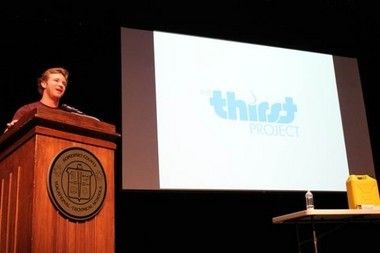 Michael Welch giving a presentation on the Thirst Project at a SCVTHS school-wide assembly.