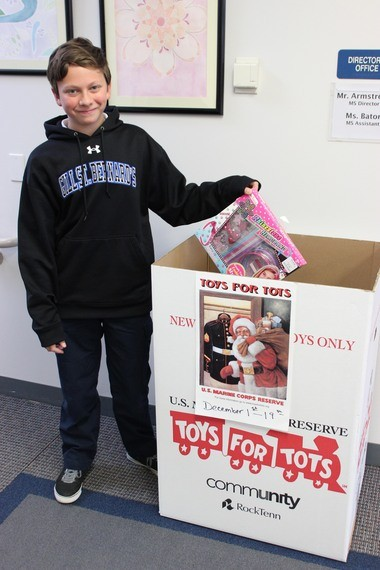Hundreds of Gill St. Bernard's students, faculty members and families in Gladstone offered a helping hand to underserved individuals this holiday season. Pictured is Matt Raymonds '21 of Warren donating to Toys for Tots program. (courtesy photo)