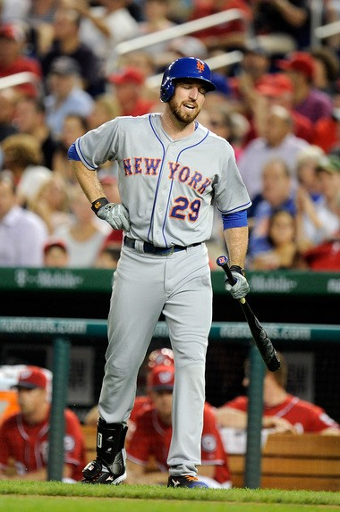 Ike Davis grimaces after suffering an oblique injury in Saturday's game.