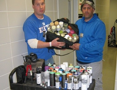 Port Authority police Officers Korbul, left, and Vogelman with the spray paint they confiscated early today. The officers arrested two men they say sprayed graffiti on a PATH train, then assaulted a police officer.