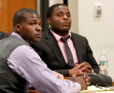 Christian Tinli, left, and Cash Johnson, right, listen to testimony during their trial in New Brunswick