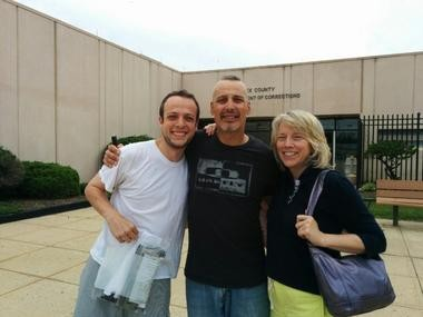 Charlie Kratovil, left, poses with his parents after being bailed out of Middlesex County jail. After contempt charges were dismissed, the family will get back $25,000 in bail money.