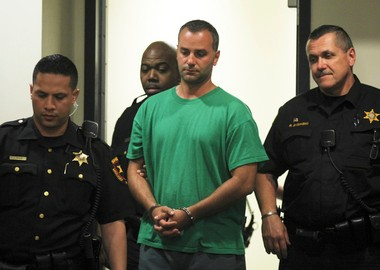 Edison police officer Michael Dotro, seen here at his arraignment in May 2013, is charged with setting fire to the home of his supervisor, Capt. Mark Anderko. (File photo)