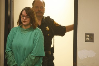Michelle Lodzinski enters a courtroom in New Brunswick in October 2014 for a status conference. Lodzinski, a former South Amboy resident, is accused of murder in the death of her 5-year-old son, Timothy Wiltsey, in 1991. (Patti Sapone | NJ Advance Media for NJ.com)