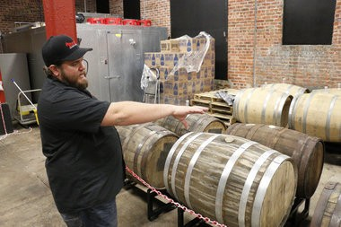 Tom Zuber shows barrels aging booze at Demented Brewing Co. in Middlesex Borough. (Brian Amaral | NJ Advance Media for NJ.com)