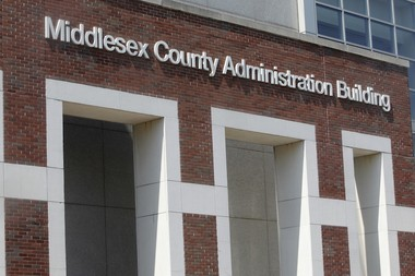 Middlesex and Monmouth counties are merging medical examiner services for 10 years.