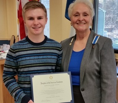 Scott Schipmann is presented with the 4th Annual Middlesex County Good Citizenship Award by Jersey Blue Chapter Regent Susan Luczu.