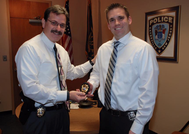 Sayreville police detective Matt Kurtz, right, receives his new badge during his promotion to detective in November. (Facebook)