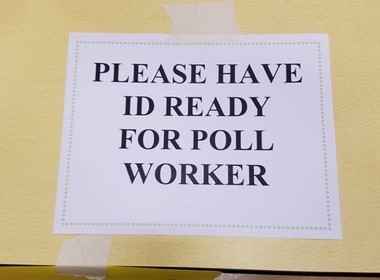 A sign posted at a polling location in Metuchen urged voters to have identification ready to show poll workers. (Courtesy of the ACLU).