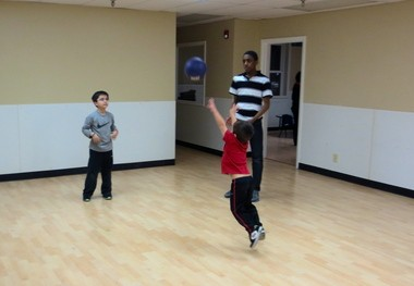 Youngsters toss a ball around at the Kickin' It KickinâIt Kids Anti-Bullying and Leadership Center in Freehold.