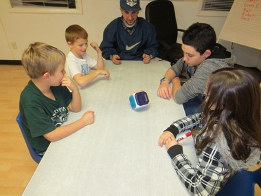 A mentor plays a game with children at the KickinâIt Kids Anti-Bullying and Leadership Center in Freehold.
