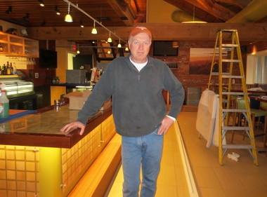 Chris Wood, owner of Woody's Ocean Grille in Sea Bright, stands in his restaurant a week before it is scheduled to open for the first time since Hurricane Sandy.